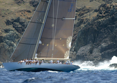 Wild Horses, W76, Spirit of Tradition, Racing Sloop sailing next to rocky cliffs